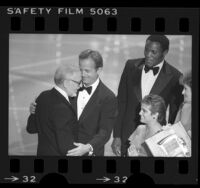 Peter Ueberroth, Rafer Johnson and Mary Lou Retton presenting David L. Wolper with Emmy Award, 1984