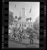 Aztec Indian dancers performing before crowd at Los Angeles City Hall during Street Scene Festival, 1984