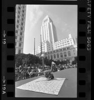 Break dancer performing for crowd at Street Scene Festival in front of Los Angeles City Hall, 1984