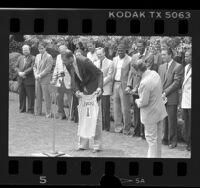 Kareem Abdul-Jabbar presenting No. 1 Laker jersey to President Ronald Reagan, 1985