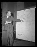 Engineer Jack E. Mauer using map to show his idea of Pomona Freeway route during California Highway Commission hearing