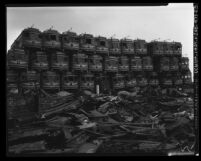 Pacific Electric Railway cars piled atop one another at junkyard on Terminal Island, Calif., 1956