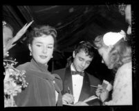 "Actor Sal Mineo with actress Gigi Perreau signing autographs at the 1956 premiere of ""The Man in the Gray Flannel Suit"", Los Angeles, 1956"