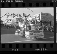 East Los Angeles Christmas parade, Olympic Torch runners float, Los Angeles, Calif., 1984