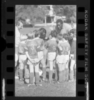 Olympic athlete Rafer Johnson coaching a youth soccer team in Van Nuys, Calif., 1984