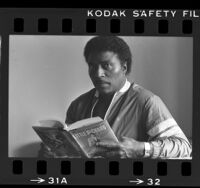 Little Richard reading his biography, 1984