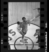 Overhead view of USC's basketball player Derrick Dowell and Oregon State's A.C. Green on tip-off, 1985