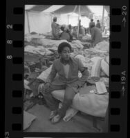 Jose Alvarez sitting on a cot in the Tent City for the homeless in Los Angeles, Calif., 1984