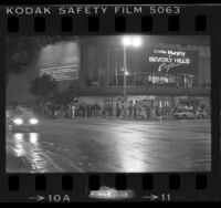 "Line of people waiting outside movie theatre to see ""Beverly Hills Cop"" in Los Angeles, Calif., 1984"