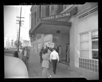 Picketing of A.F.L. Teamster Union building by members of the  I.B.E.W. union in 1947, Los Angeles, Calif.
