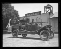 Unidentified man and boy in Sawtelle Fire Engine, Calif., circa 1925