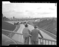 Two men on bridge at Boyle Ave. looking out over the Santa Ana Parkway, Los Angeles, 1947