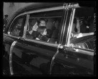 Actress Lauren Bacall riding in car with her daughter and son after memorial services for Humphrey Bogart, Los Angeles, Calif., 1957