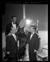 Jayne Mansfield with jockeys Johnny Longden, Eddie Arcaro and Willie Shoemaker at Jockeys' Ball in Los Angeles, Calif., 1957