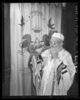 Michel Levitt sounds Shofar, signaling Rosh Hashana in Los Angeles, Calif., 1946