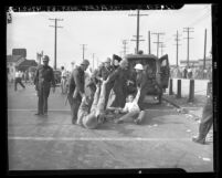 Los Angeles police dragging three studio strikers off to jail in 1946