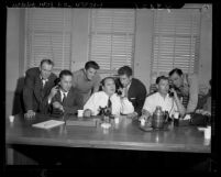 Seven actors and studio workers during telephone conference with A.F.L. officials in Los Angeles, Calif., 1946