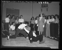 Agnes S. Albro, newly appointed police commissioner, inspects policewomen training in Los Angeles, Calif., 1946