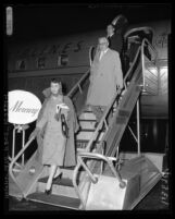 Actress Jennifer Jones and husband, producer David O. Selznick disembarking plane in Los Angeles, Calif., 1957