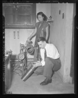 Student Yi Hsien Sha and Dr. Corwin H. Hansch assembling catalytic chamber in laboratory at Pomona College, Calif., 1948