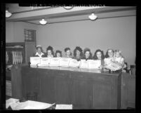 Eight women attorneys holding their certificates after being sworn into the California Bar, 1948