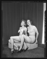Two women modeling bathing suits for California Apparel Creators Market Week in Los Angeles, Calif., 1948
