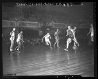 Andy Wolfe and Guy Buccola during UC vs UCLA basketball game, 1948