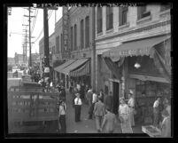 Crowds gather in 700-block North Alameda street after police raids in Los Angeles, Calif., 1938