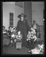 Harry Chandler greeting from Olvera Street children, Los Angeles, 1938