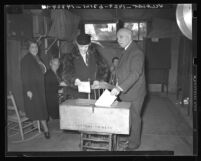 California Governor Frank Merriam and his wife casting ballots in Long Beach, Calif., 1938