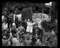 Reporters surrounding actors Tyrone Power and Annabella after their wedding ceremony in Bel-Air, Calif., 1939