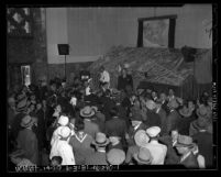 Crowd listening to a barker during opening week tour of Los Angeles Union Station in 1939