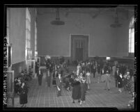 People in the east wing ticket concourse of Los Angeles Union Station during opening week in 1939