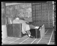 Man sleeping in chair in the waiting area of Los Angeles Union Station, 1939