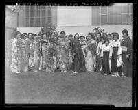 "Akiko Tsukimoto, arriving with ""Friendship Flame"" from Japan meeting priest H. Araki in Los Angeles, Calif., 1939"