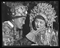 Roland Gott and Kwai On, actors in a theater company based in Los Angeles' Chinatown, 1939