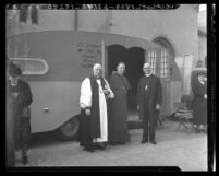 Bishops standing before St. Christopher Catholic Church's Chapel Trailer, Calif., 1940