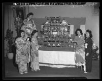 Women with display at Japanese Doll Festival in Little Tokyo, Los Angeles, Calif., 1940