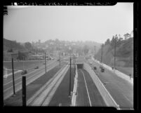 Cahuenga Pass Freeway, view looking south to the junction of Cahuenga and Highland Aves in Los Angeles, 1940