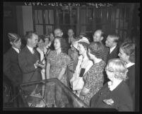Phil Kerr, radio director of Aimee Semple McPherson's Angelus Temple, interviewing parishioners, 1940