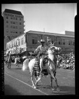 Leo Carrillo on horseback in parade for 17th annual old Spanish Days Fiesta in San Barbara, Calif., 1940