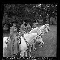 Five women riding Camarillo white horses during Old Spanish Days Fiesta in Santa Barbara, Calif., 1965