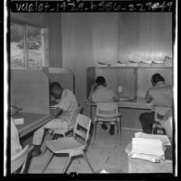 Boys studying class work at Fenner Canyon Job Corps camp, Calif., 1965