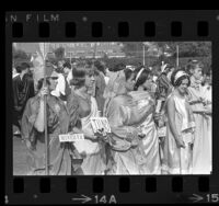 Group of teenage girls dressed in togas during convention of the Junior Classical League at USC in Los Angeles, Calif., 1965