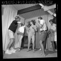 Group of teenagers dancing the Watusi in Los Angeles, Calif., 1965