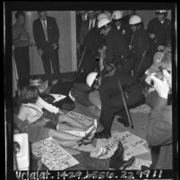 Police struggling with picketing CORE members in front of the Mayor's Office at Los Angeles City Hall, 1965