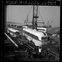 Los Angeles electric streetcars being loaded aboard the Liberian ship Santa Helena at Long Beach Harbor, Calif., 1965