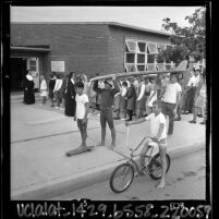 Students filing into the American Martyrs School on first day of classes as public school students play in Manhattan Beach, Calif., 1965
