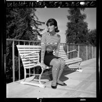 Female high school student modeling clothes that does not follow Los Angeles Unified School District's 1965 dress code
