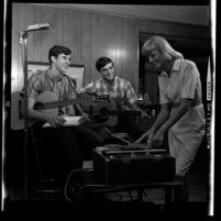 Three members of the folk-rock music group The Legendaires recording a song in Glendora, Calif., 1965